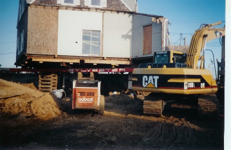 Demolition. This home was stripped back to inner walls and a new foundation was installed under the remaining structure.